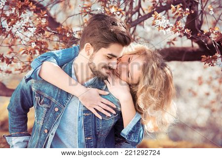 Young couple in love outdoor.Loving couple smiling and enjoying outdoors.