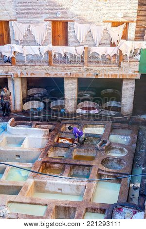 FEZ, MOROCCO - DECEMBER 10: Men working at tannery pools for leather production in Fez. December 2016