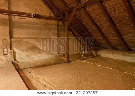Attic loft insulation. Old loft. renovation and thermal insulation with mineral rock wool