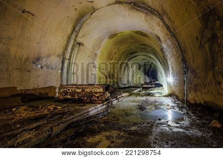 Old abandoned flooded drainage tunnel of mine or sewer system