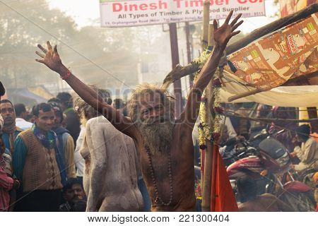 BABUGHAT, KOLKATA, WEST BENGAL / INDIA - 11TH JANUARY 2015 : Hindu Sadhu with white ash applied on body and face, blessing Indian devotee men.