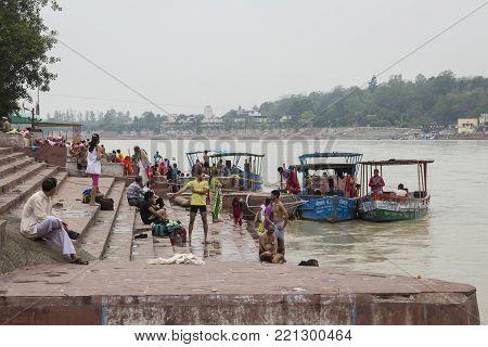 Rishikesh, India - June, 24, 2015 view of people in Ganga river embankment in Rishikesh, Rishikesh is one of sacred city of hinduism.