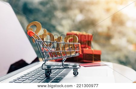 Shopping cart with happy new year 2018 concept.