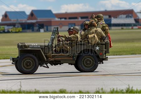 READING, PA - JUNE 3, 2017: World War II reenactment of a battle between American infantryman and German soldiers at Mid-Atlantic Air Museum World War II Weekend and Reenactment