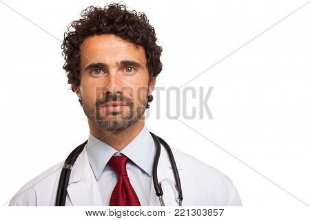 Portrait of an confident doctor. Isolated on white