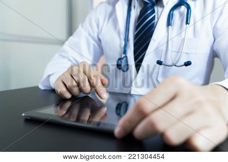 Doctors working in hospitals. hand holding using tablet. doctor using tablet vintage tone. doctor using tablet concept. doctor using tablet closeup on hand.