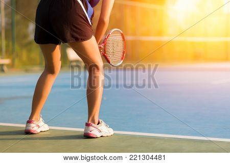 Woman playing tennis and waiting for the service. sunset. tennis on sunset. tennis sport girl. tennis racket. tennis player