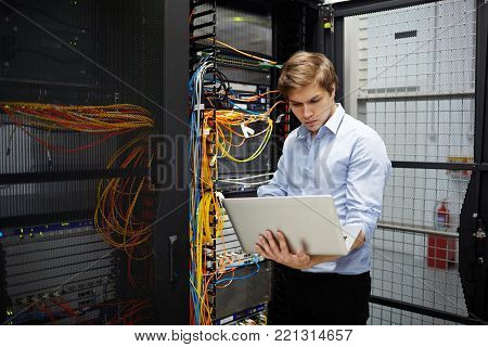 Young contemporary programmer checking system of data storage in mining farm