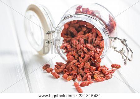 Dried goji berries in jar.