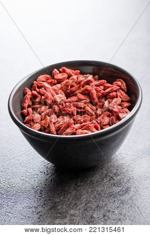 Dried goji berries in bowl.