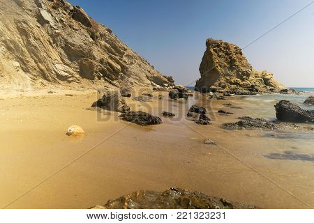 Long exposure at Lolantonis beach in Paros island in Greece with a seashell at the foreground.