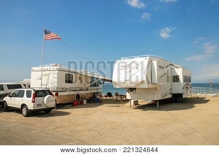 VENTURA COUNTY, CALIFORNIA, USA - OCTOBER 06, 2006. Mobile homes and other recreational vehicles in a parking lot in next to the coast of Faria Beach National Park.