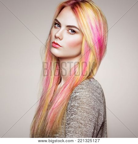 Beauty Fashion Model Girl with Colorful Dyed Hair. Girl with perfect Makeup and Hairstyle. Model with perfect Healthy Dyed Hair. Rainbow Hairstyles