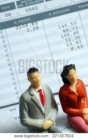 Euro Payroll And Woman And Man Figurine