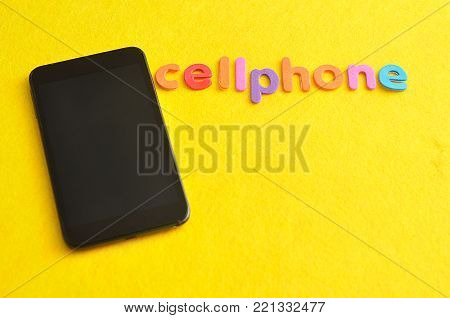 The word cellphone displayed with a cellphone on a yellow background
