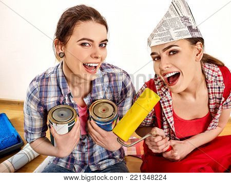 Repair home women holding bank with paint for wallpaper. Elderly mother and daughter renovation apartment on isolated. Loan for housing for students. Sisters paint walls.