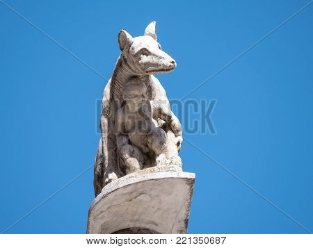 Statue of the Capitoline Wolf that fed twins Romulus and Remus, founders of Rome, in front of the west facade of the Cathedral of Siena. Legend has it that the sons of Remus founded Siena.