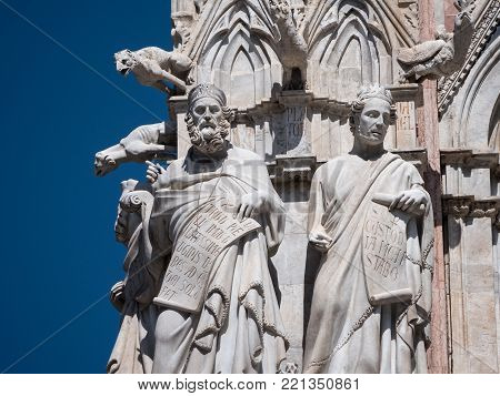 Statues of saints and gargoyles on the west facade of the Cathedral of Siena