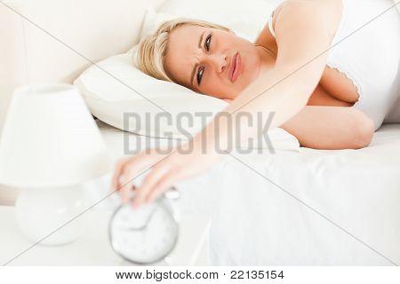 Upset Blonde Woman Waking Up