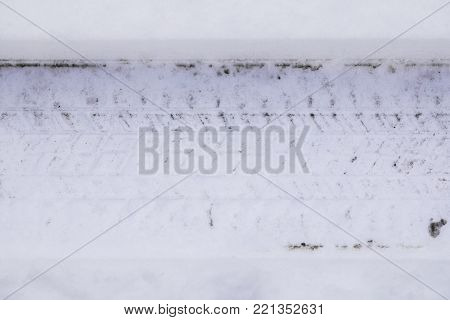 Tire tread tracks in fresh snow close up