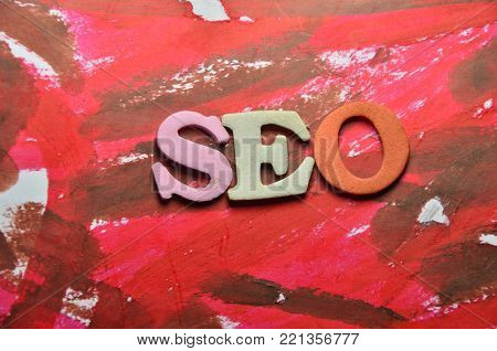 word seo on a  abstract colored background