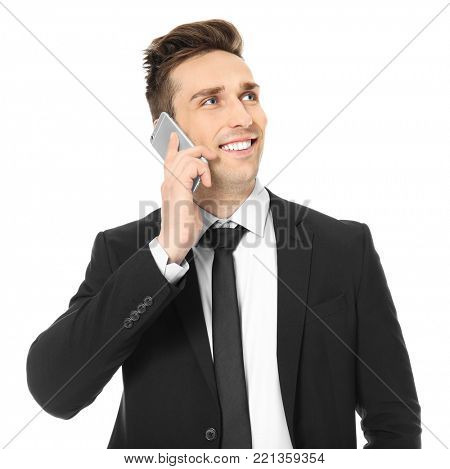 Young man in formal clothes with cell phone on white background