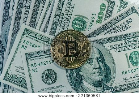 A Symbolic Coins Of Bitcoin On Banknotes Of One Hundred Dollars