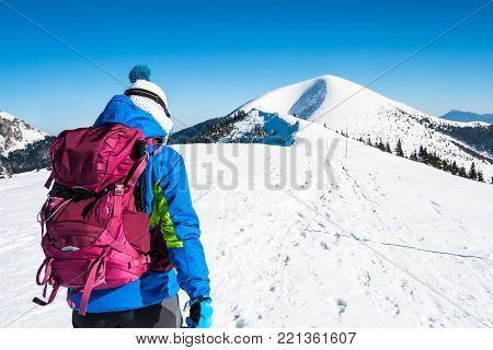 Woman on mountain top, Self confident woman in winter mountains, Symbol winter experience, Background hiker in mountains, Sporting woman in mountains, Snowy mountains with tourist