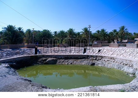 Pond in the center of Shithathah town at Al Mardh oasis near Karbala, Iraq