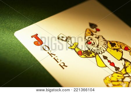 CLECKHEATON, WEST YORKSHIRE, UK: JOKER PLAYING CARD ON GREEN CLOTH GAMING TABLE, CIRCA 2007, CLECKHEATON, WEST YORKSHIRE, UK