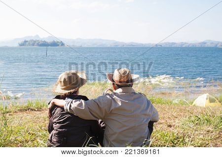 Happy senior travelers sitting together in nature, Healthy senior or older people, Happiness living concept poster