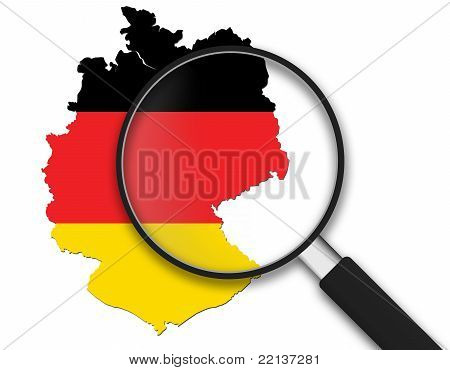 Magnifying Glass with a German Map on white background. poster