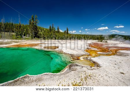 Hot thermal spring Abyss Pool in Yellowstone National Park, West Thumb Geyser Basin area, Wyoming, USA
