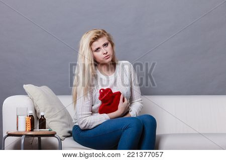 Sad Sick Woman Lying On Couch Having Flu