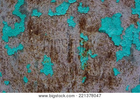 Close up texture of cracked cian dye on obsolete weathered cement wall surface