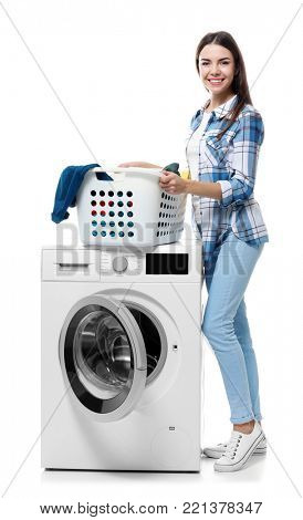 Young woman doing laundry on white background