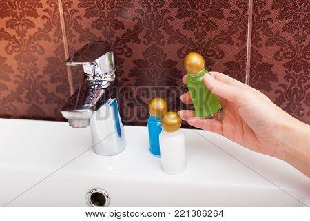 Hotel cosmetics kit into hand. Bathroom. Health