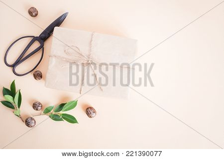 Brown Gift Box On Yellow Background,handmade Gift Box And Scissors,christmas Concept Top View