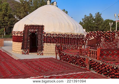 Ethnic nomadic yurt-building and trestle-bed, built for the celebration of Kurban-Bairam.
