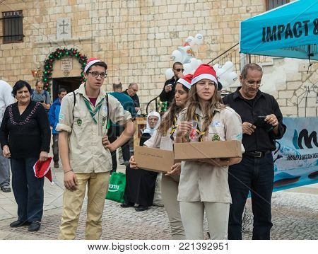 Mi'ilya, Israel, December 22, 2017 : Participants of the support group award commemorative medals to the participants at the finish of the annual race