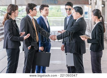 Group of Business people shaking hands,Teamwork finishing up a meeting partners greeting each other after signing contract and go Seminar.