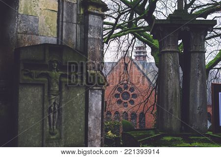 December, 29th, 2016 - Ghent, East Flanders, Belgium. Saint Amandus chapel on Campo Santo historical cemetery in Sint-amandsberg municipality, Gent. Roman church, ancient tombs, graves and monuments.