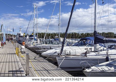 ULVON, SWEDEN ON July 18. View of a marina by the seaside on July 18, 2017 in Ulvon, High Coast Heritage, Sweden. Sunshine and yachts. Unidentified people. Editorial use.