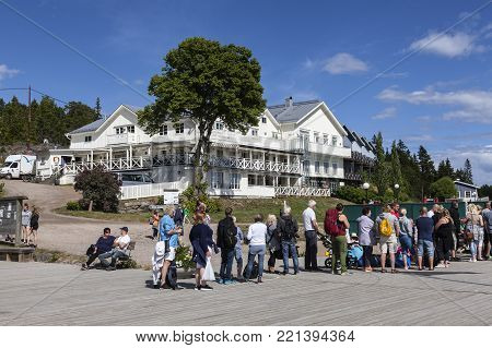ULVON, SWEDEN ON JULY 18. Exterior of the local hotel and restaurant on July 18, 2017 in Ulvon, Sweden. Line-up to the departure ship this side. Unidentified person. Editorial use.