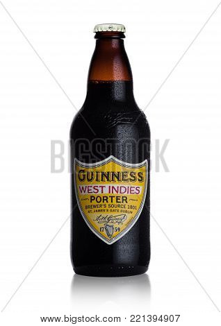 LONDON, UK - JANUARY 02, 2018:  Bottle of Guinness west indies porter beer on white background. Guinness beer has been produced since 1759 in Dublin, Ireland.