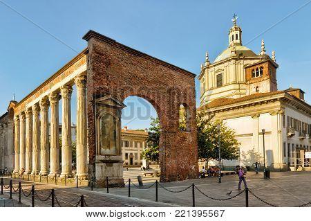 Milan, Italy - May 22, 2017: Ancient Roman columns of San Lorenzo and Basilica of San Lorenzo Maggiore (Saint Lawrence).