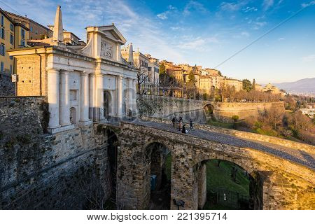 BERGAMO, ITALY - DECEMBER 24, 2016: View of the San Giacomo gate in the old town of Bergamo in Italy at sunset on December 24, 2016