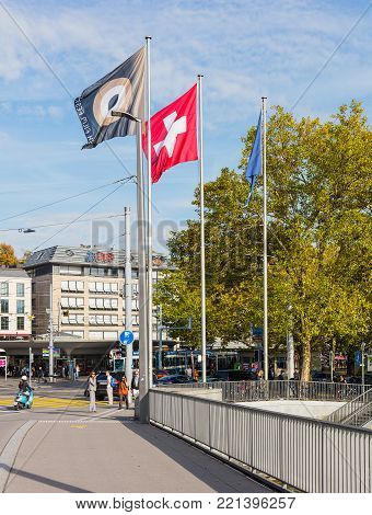 Zurich, Switzerland - 29 September, 2017: view from Quaibrucke bridge towards Bellevue square, flags of Zurich Film Festival, Switzerland and Zurich. Zurich is the largest city in Switzerland and the capital of the Swiss canton of Zurich.
