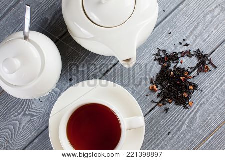 Cup of tea with teapot. Wood background