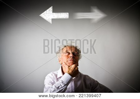 Old man in white has to decide between two directions.